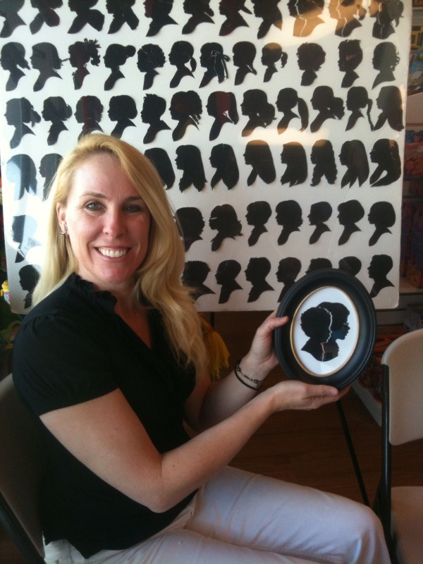 Kathryn Flocken with her display of silhouettes
